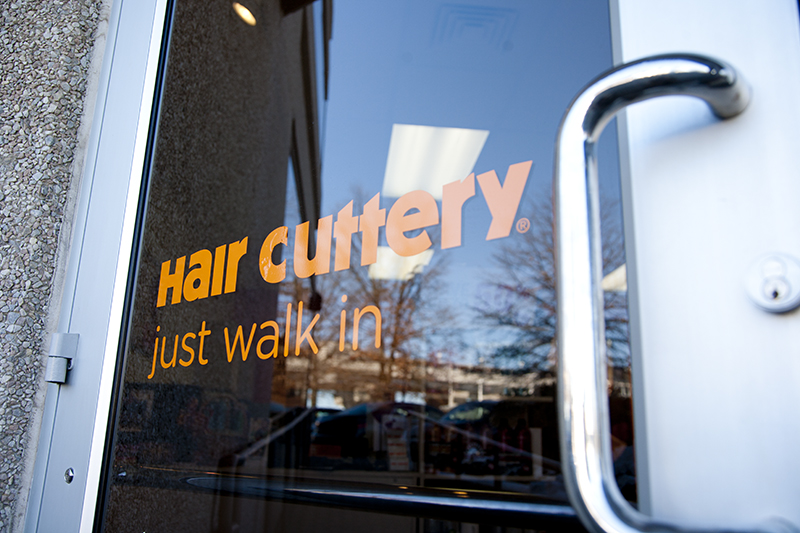 salon door with decal that reads 'Hair Cuttery Just Walk In'