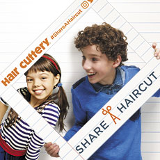 Kids with a Share-A-Haircut selfie frame